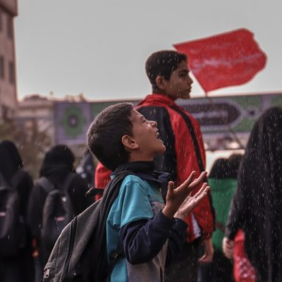 Reaching for raindrops - joyful moment, surrounded by ideology - Iran (Photo by F Alaie)